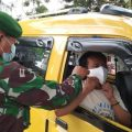 National soldier is giving mask to West Papua's society